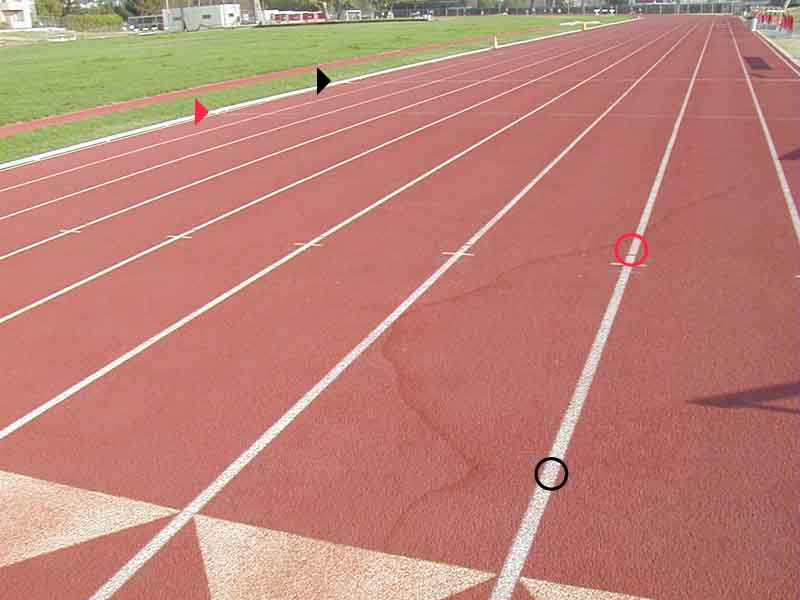 examples of track markings 200-meter track diagram here are the various hurdle marks on this track in the foreground circle is a fain yellow mark on the lane line it is the reverse 100h mark it is 10 5m